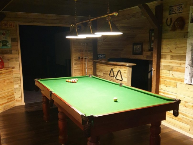 Bluegum Timber Slab used for this bar top and pool room lined with timber throughout. Timbers available from Tradeware Building Supplies Brisbane