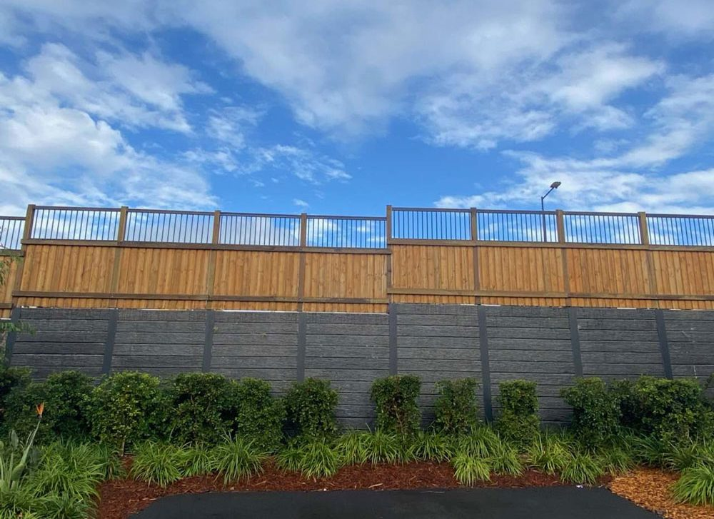 Treated Pine Fence on top of Sleeper Retaining Wall. All timber available from TRADEWARE Building Supplies, Chandler Brisbane, quality timber suppliers.