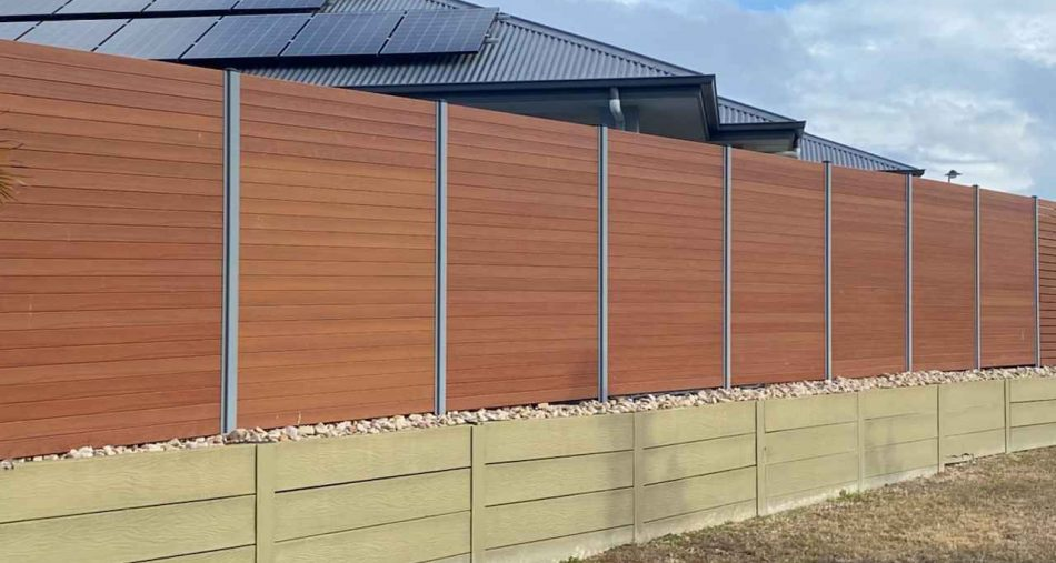 Treated Pine Fence on top of Treated Pine Sleepers Retaining Wall. Timber available from Tradeware Building Supplies Brisbane