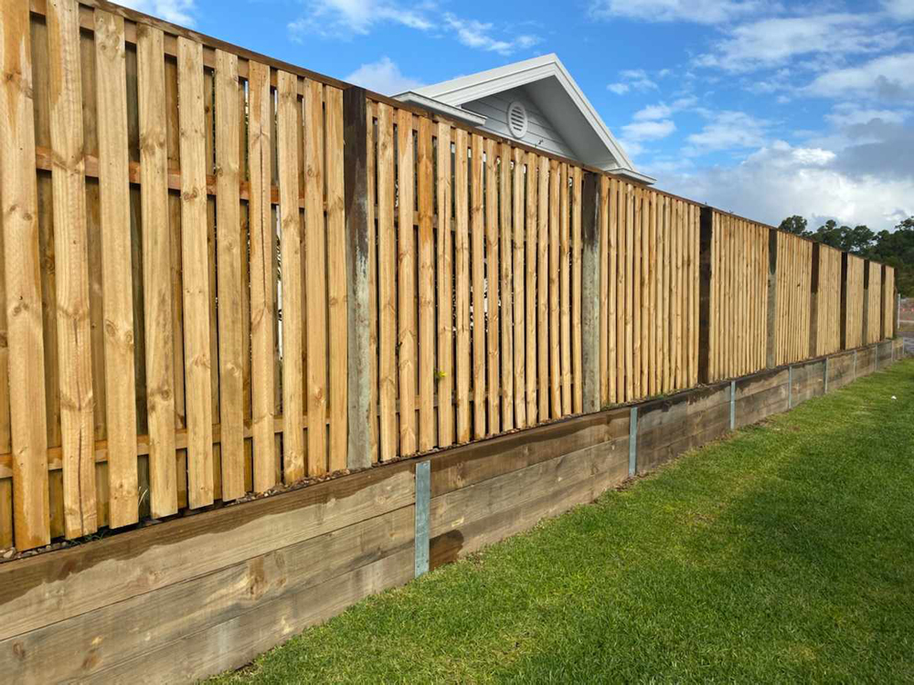Landscaping Products - image Treated-Pine-Fence-On-Top-Of-Treated-Pine-Retaining-Wall-2-1 on https://tradewarebuildingsupplies.com